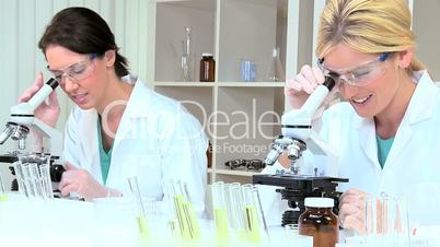 Female Lab Assistants Using Test Tubes