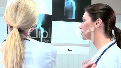 Hospital Doctors Examining X-Ray Film