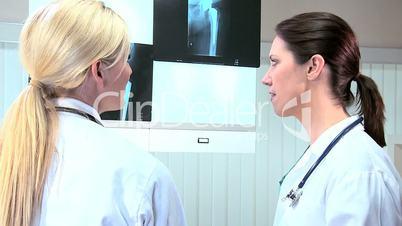 Caucasian Doctors Examining X-Ray Results