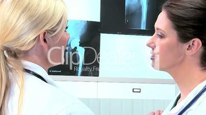 Hospital Doctors Examining X-Ray Results