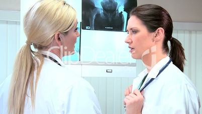 Female Doctors Inspecting X-Ray Results