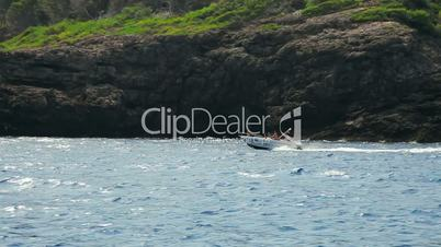 Fast motorboat jumps on waves of Mediterranean Sea, Mallorca Island, Spain