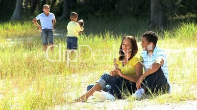 Ethnic Family Enjoying Time in Park
