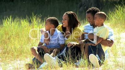 Young Ethnic Family Enjoying the Park