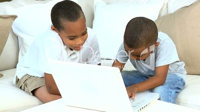 Cute Young Ethnic Boys with Laptop