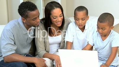 Little Ethnic Boys Using Laptop Computer with Parents