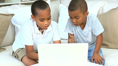 African American Boys with Laptop on Sofa