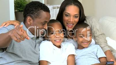 African American Family Watching TV Together
