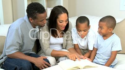 Parents and Little Ethnic Boys Reading a Book