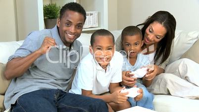 Young Family Having Fun with Electronic Game Console