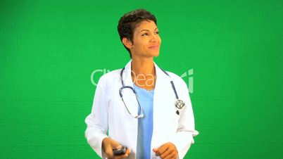 Remote Control Green Screen Ethnic Female Doctor