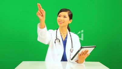 Asian Chinese Female Doctor Green Screen Wireless Tablet