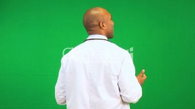 Male Ethnic Doctor Pleased Green Screen Demonstration
