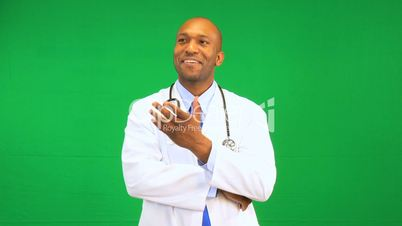 Ethnic Male Doctor Satisfied Green Screen Demonstration