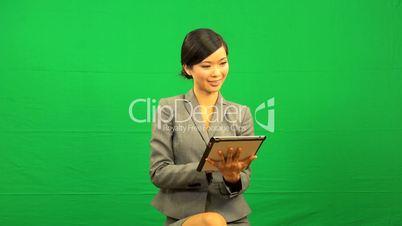 Asian Businesswoman Green Screen Tablet