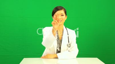 Asian Female Doctor Touch Screen Green Screen