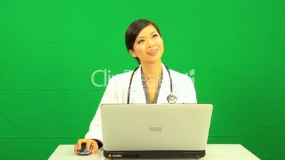 Female Asian Doctor Laptop Green Screen