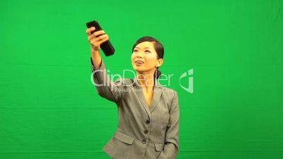 Asian Business Female Remote Control Green Screen