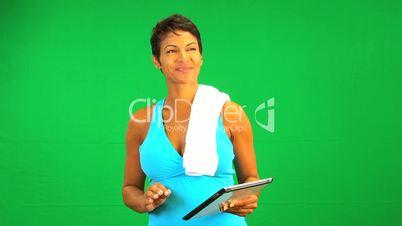 Ethnic Female Wireless Tablet Green Screen Fitness