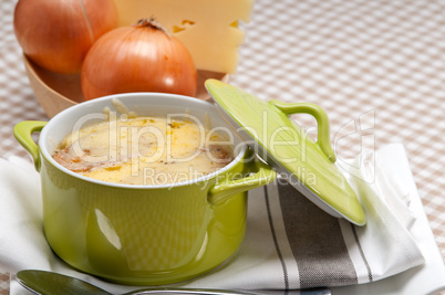 onion soup with melted cheese and bread on top