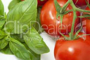 Basil and tomatoes close-up