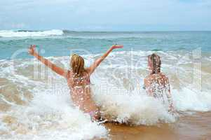 BENTOTA, SRI LANKA - OCTOBER 22: The tourists on beach and turqu