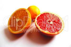 orange grapefruit and lemon divided in half