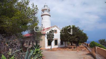 Lighthouse on hill in Port de Soller, Mallorca Island, Spain, Balearic Islands