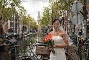 AMSTERDAM, APR 30: Bride waits for Groom over city canal, April