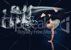 Martial arts expert doing hand stand against broken glass backgr