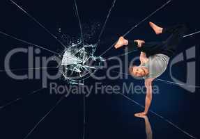 Martial arts expert against broken glass background