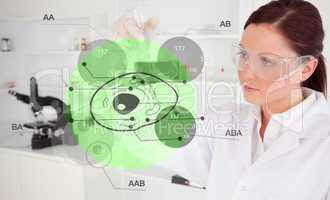 Chemist examining green cell interface