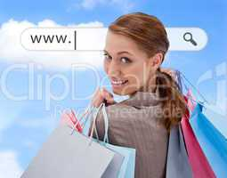 Woman looking over her shoulder with shopping bags under address bar