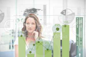 Blonde businesswoman using green chart interface
