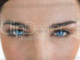 Attractive blue eyed woman with binary coding on face