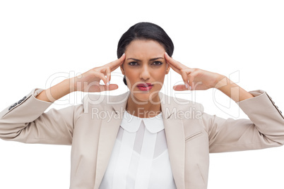 Concentrated young businesswoman putting her fingers on her temp