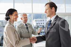 Businessman introducing a colleague