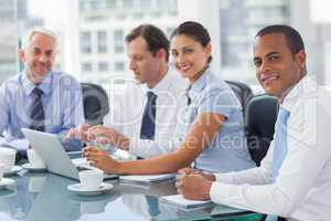 Smiling business people brainstorming