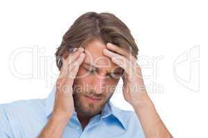 Tanned man having a headache