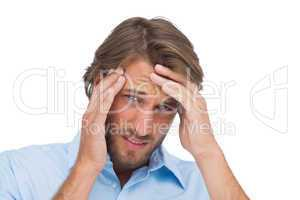 Tanned man having a strong headache