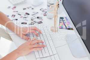 Female editor typing on keyboard