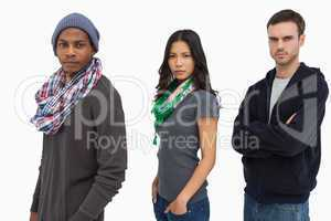 Stylish young people in a row looking serious