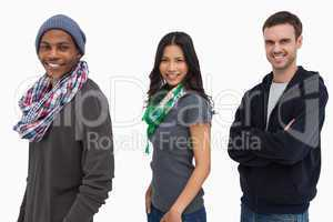 Stylish young people in a row looking happy