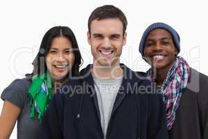 Stylish young people smiling at camera