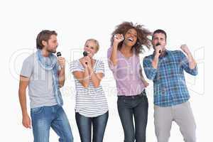 Fun group singing at karaoke
