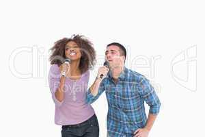 Fun duo singing at karaoke