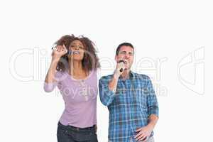 Fun pair singing at karaoke