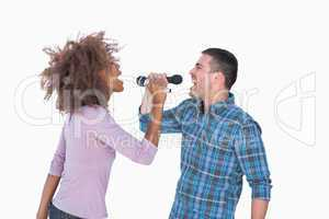 Fun duo singing to each other at karaoke