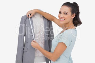 Fashion designer measuring blazer lapel