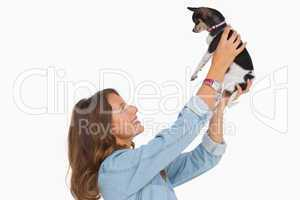 Pretty woman lifting her chihuahua up